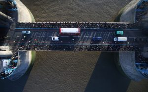 LONDON, ENGLAND - NOVEMBER 10:  Traffic and pedestrians flow across Tower Bridge, over the River Thames, seen through a new glass floor in the bridge's walkway on November 10, 2014 in London, England. Unveiled today the glass floor panels along the bridge's high-level walkways weigh 300 kgs each, cost £1m and will give visitors a new view over the historic bridge crossing The River Thames.  (Photo by Peter Macdiarmid/Getty Images)